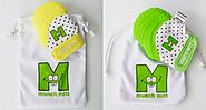 Gifts for Tiny Tots & New Parents | Shop - Munch Mitt Baby Teething Mitten USA