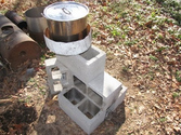 Homemade Rocket Stoves | Simple pot skirt on Rocket stove for higher efficiency