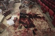 Shoes lie in Blood on the Auditorium floor at the Army Public School