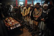 Pakistani Mourners Pray During the Funeral of a Student