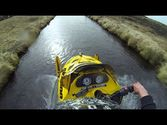 Snowmobile Down Rapids in Iceland - TRAVEL MEDIA HOTELS DISCOUNTS COMPARE HOTELS RATES