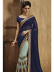 VINTAGE FLAVOUR 9022:- Net Skirt Saree With Mirror Work Running Borders.Pallu In Navy Chiffon And Blouse In Navy Dupion