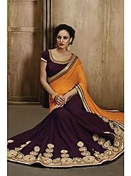 VINTAGE FLAVOUR 9025:- Wing Georgette Saree With Pallu in Orange Chiffon.Blouse in Wine Dupion With Embroidered Neck.