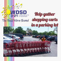 Help gather shopping carts in a parking lot