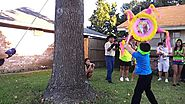 Neon Birthday party piñata hitting for the kids