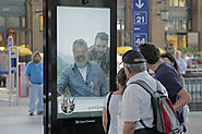 The Swiss Mountain Man in This Interactive Billboard Yodels and Gives People Free Train Tickets