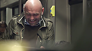 Why Coca-Cola Hired This Man to Laugh Really, Really Hard on a Crowded Subway Train