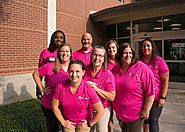 The Coppell Parks & Recreation Department team shows off their new pink shirts for Breast Cancer Awareness Month