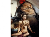 Carrie Fisher in a gold bikini chained to a fat alien.