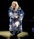 Rihanna hits a fan with microphone for grabbing her during Birmingham concert