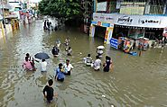 People wade through a flooded street in Chennai(AP Photo)