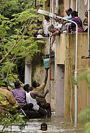 Stranded residents are supplied food in the Kotturpuram area in Chennai.(R Senthil Kumar/Press Trust of India via AP)