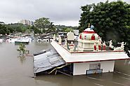 A Hindu temple is partially submerged in flood waters of an over-flowing Adyar river in Chennai.(AP Photo)