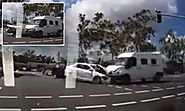 Terrifying moment a van sends a taxi flying after head-on smash in the middle of a busy intersection - but could the ...