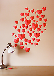Make a wall of paper hearts | How About Orange