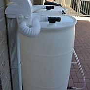 Collecting rain water with the help of plastic rain barrels