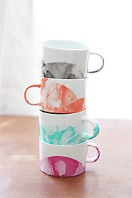 DIY Marbled Mugs with Nail Polish - diycandy.com