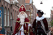 Sinterklaas and his helper Zwarte Piet Hand Out Candy and Gifts On Dec 5th In The Netherlands