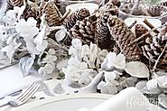 Pine cone candle holder centerpiece surrounded by frosted flowers