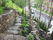 How to Build a Natural Stone Retaining Wall the Right Way!