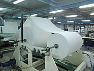 A Roll of Tissue Paper Raw Material set on machine for Production