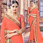 Orange Saree With Round Necked Open Back Broad Lace Bordered Blouse