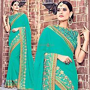 Latest Sea Green Party Wear Sari With Transparent Back Sleeveless Blouse