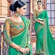 Party Wear Georgette Saree With Three Four Sleeves Round Necked Blouse