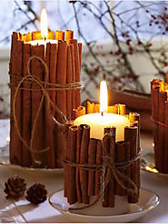 Pillar candles wrapped in cinnamon sticks - Decoist