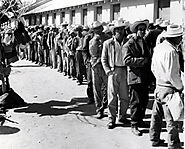 Braceros waiting in line for processing at the Rio Vista Reception Center, El Paso, Texas.