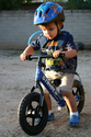 Should a helmet be worn when riding a balance bike?