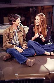 In the show, Donna is one month older than Eric. In real-life, Topher Grace is two years older than Laura Prepon.