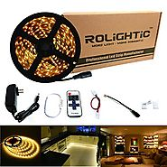 RoLightic LED Strip Light 16.4ft 300leds Warm White 3000K 3528 Led Tape Lights Full Kit with RF Remote Dimmer & 2A Po...