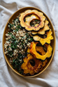 Roasted Acorn Squash + Apples with Quinoa, Kale, + Tahini Maple Dressing