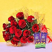 Buy/Send Red Blooms With Chocolaty Treats Online - YuvaFlowers.com