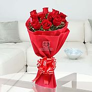 This stunning bunch of 10 Red Roses with seasonal filler wrapped beautifully in red paper - OyeGifts.com