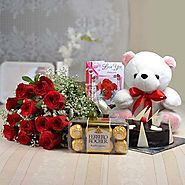 12 Red Roses & Teddy With Ferrero Rocher & Half Kg Chocolate Cake