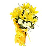 12 White Roses with 3 Yellow Lilies in Yellow Paper packing.