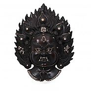 Website at https://www.craftvatika.com/large-mahakala-black-mask-himalayan-tibetan-art-wall-hanging.html