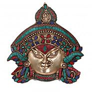 Website at https://www.craftvatika.com/durga-shakti-brass-wall-hanging-indian-goddess-kali-maa-wall-mask.html
