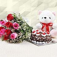 Buy Adelicious, 1 Pound Blackforest cake, 10 beautiful red roses and a lovable teddy bear 6 inch. - OyeGifts.com