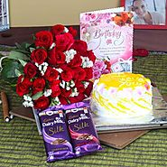Buy/Send Roses with Pineapple Cake and Cadbury Silk for Birthday - YuvaFlowers