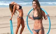 Hula girl! Audrina Patridge tones her lean bikini body with a hoop workout on the beach