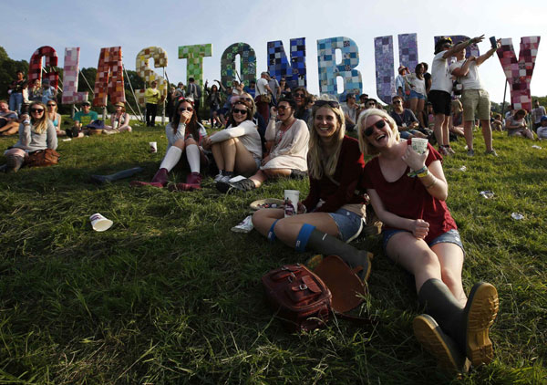 Headline for Our Muddy City: 10 Community Lovin' Photos from the Glastonbury Festival in Recent Years.