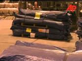 Aid being loaded onto a plane in Sydney heading for Samoa 2009 News